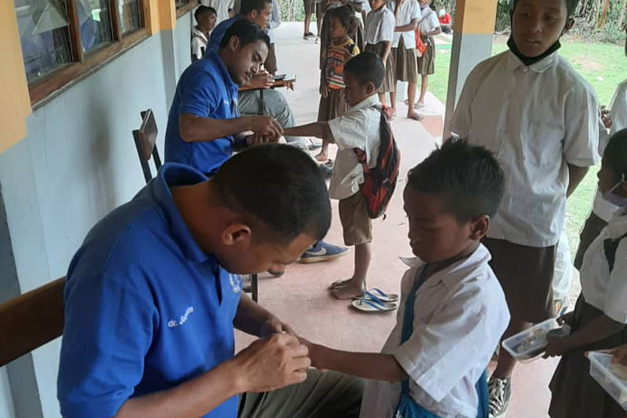 Primary school children undergoing clinical skin examinations in Timor-Leste